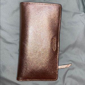 Kate spade wallet in rose gold